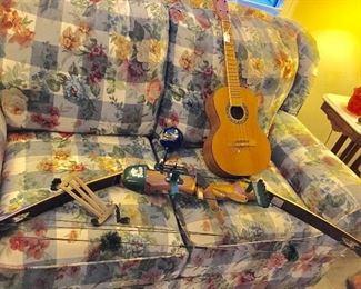 Fred Bear Archery bow, vintage ukulele, Mexican maracas