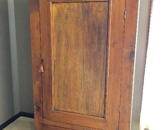 Antique armoire with drawer and hanging bar
