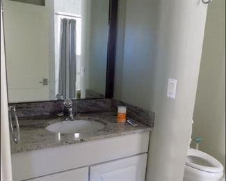 Kids Bath with a Double Granite Vanity and Whirlpool Tub.