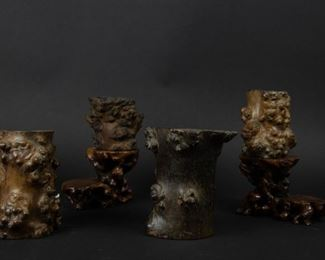 A Group of Burl Brush Pots and Stands