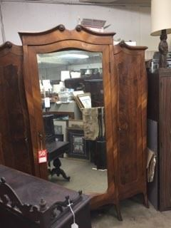 An armoire with a full-length mirror.