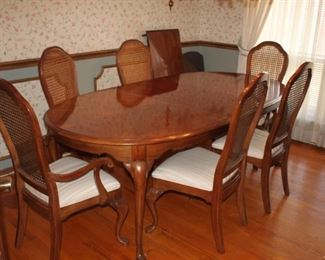 Great American made dinette set. Heavy red oak. Beautiful condition with six chairs and two large leaves and pads.  Got a big family?  Many guests this is the set for you.