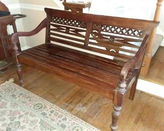 Two different vintage wood benches, one with ventilated bottom, on with solid bottom for a cushion. West Indies plantation style.