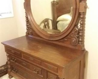 """The """"Lincoln Bedroom""""! Unusual antique solid wood double sized bed frame, and matching dresser with mirror. Dresser and mirror pictured."""