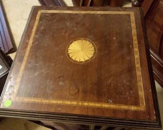 Vintage mahogany with inland revolving bookshelves.