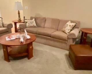 Fabulous like-new Stickley Furniture - including the two Sofas (they look drab in this pic, but they are really great looking and extremely comfortable and mint condition, also there are two leather Stickley club chairs that swivel - one shown here with an ottoman, and another.  Also the side tables and the coffee table, as well as a sofa table behind the loveseat, also an entertainment credenza and the curio cabinet.  Wowsa that's a lot of better than new Stickley furniture - some of the best you can buy!