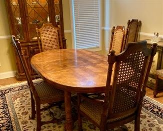 This is a  Century Dining Set - Table, six chairs, china hutch and a buffet server.  The rug is awesome, but it has no info on the back - finely made, exceptional condition as is everything else in this house!