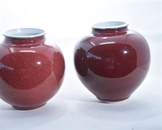 66. Two 2 Sid Oakley Oxblood Vases