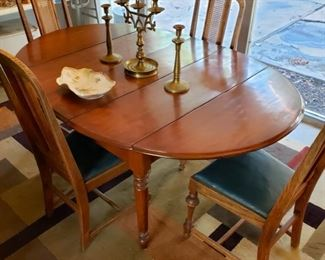 Mid century dining room table and four rattan back chairs