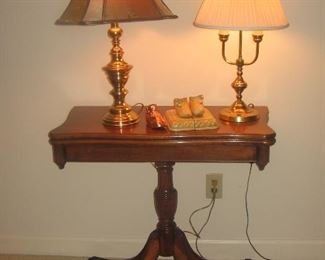Game table with lamps and baby shoes