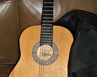 Acoustic guitar with bag...