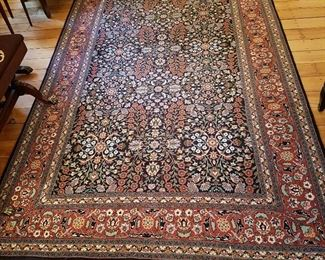 Finely knotted oriental rug in excellent condition.