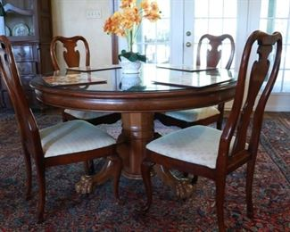 Table with glass top and six chairs