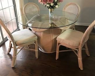 Rattan and glass dining set
