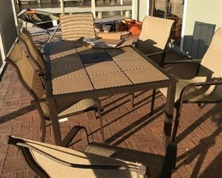 Patio table and chairs with additional replacement tiles