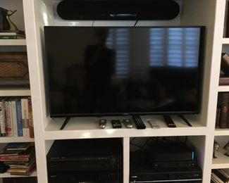 Television with sound bar and accessories