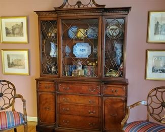 Lammerts mahogany breakfront with secretary drawer and eagle finial