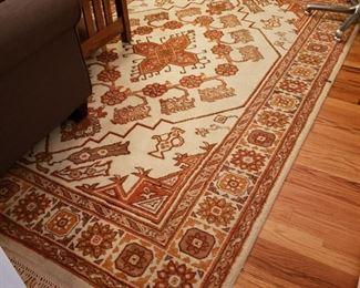 Orange and cream Oriental rug, appr. 9 feet 8 inches by 6 feet