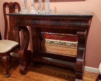 Antique American Empire mahogany marble top server with petticoat mirror