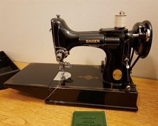 Vintage Singer sewing machine with original case