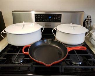 White Dansk lidded pots and a Lecreuset skillet
