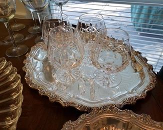 Waterford crystal brandy glasses on a silverplate tray