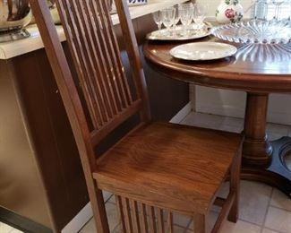 Two oak side chairs