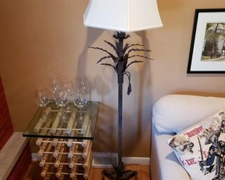 Metal palm tree floor lamp and a wine rack with glasses