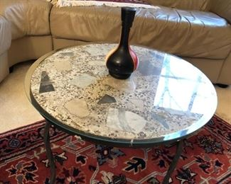 Vintage heavy wrought iron and stone table.