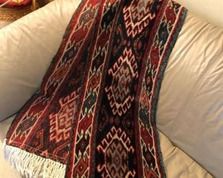 Gorgeous long tapestry rug for maybe a piano or table.