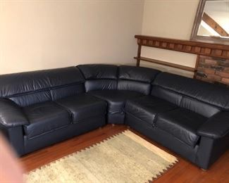 Navy blue leather sectional.