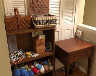 Yarn, sewing items and vintage metal Kenmore sewing machine.