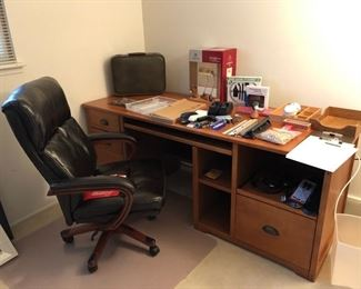Another office desk and chair.