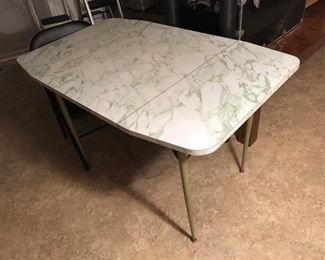 Vintage formica drop leaf table no chairs.