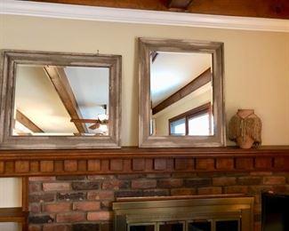 Two beautiful brand new beveled mirrors.