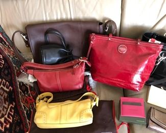 Coach and Kate Spade purses and wallets.