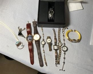 Various watches including Citizen, Movado and Brighton.