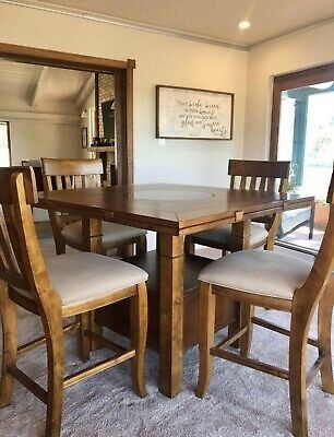 "Haverty's Sonoma Valley Gathering Table with six (6) Slat Back Barstools •	Gathering Table 46"" x 46"" x 36"", expandable to 60"" round x 36"" •	QTY of six (6) 24"" Slat Back Barstool 20"" x 18"" x 42"""
