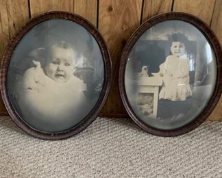 Antique photos in curved glass frames.