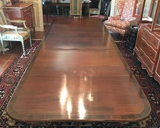 3 pedestal mahogany with inlay band Duncan Phyfe style dining room table.  Can seat up to 25 people. Includes 2 leaves.