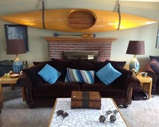 Wooden kayak, sofa, two matching lamps, end tables, countless home decor.