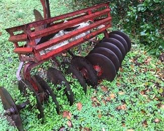 Disc harrow with stone trough in original red paint, bought in Texas
