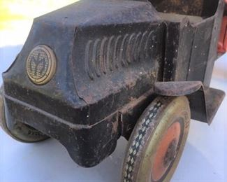 """J Chein & Co dump truck made for Mack with """"Hercules"""" printed on tires"""
