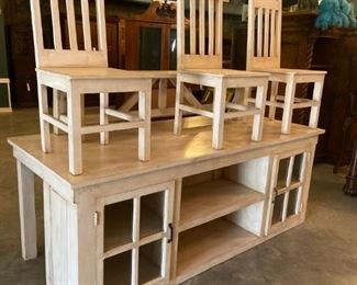dining island table with 3 chiars and bench