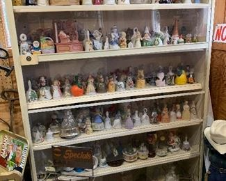 Collection of bells, figurines & music boxes, Gulf display, milk cooler box