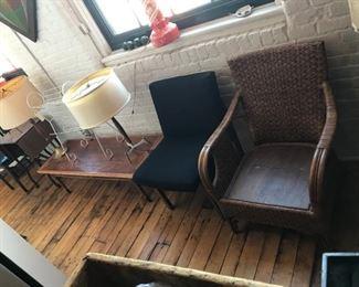 Wicker chair, wool and teak chair, Lane coffee table (as is), Lightolier lamp, wire book rack, midcentury walnut lamp
