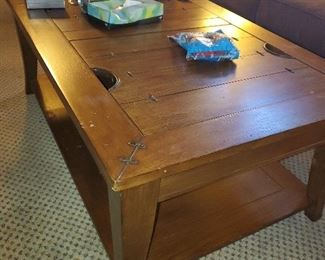 Coffee table with lift up tops for storage