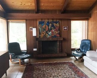The real Ekornes Chair is on the right. Check out the killer fireplace tile