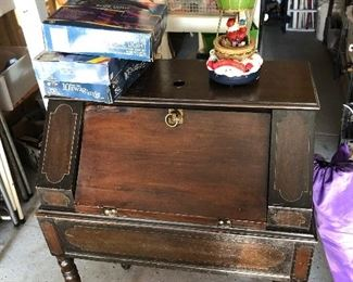 Very old and vintage sewing machine cabinet. Has hidden storage in it. $60