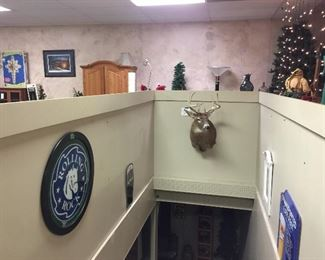 White tail deer taxidermy, Rolling Rock beer sign, LaBatt beer sign, Christmas trees
